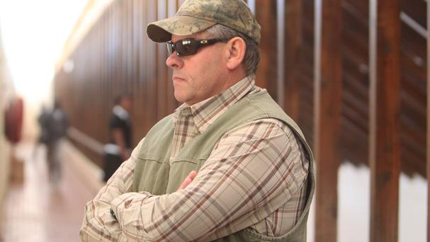 Professional hunter Theodore Bronkhorst prepares to enter a magistrates' court to face trial in Hwange, 700 kilometres south west of Harare, Zimbabwe (AP)