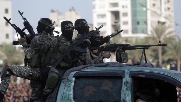 Hamas gunmen parade in the Gaza Strip. (AP)