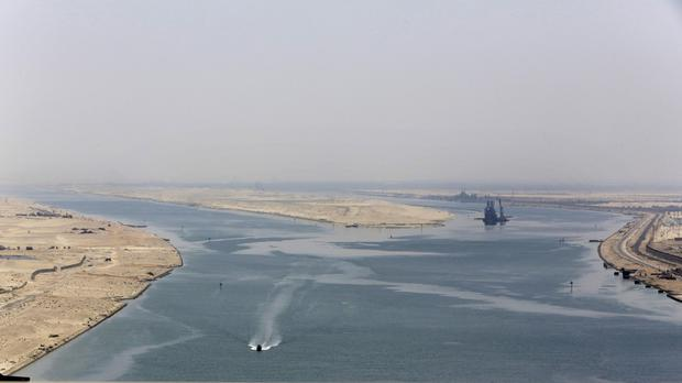 An army zodiac secures the entrance of the new section of the Suez Canal in Ismailia, Egypt (AP)