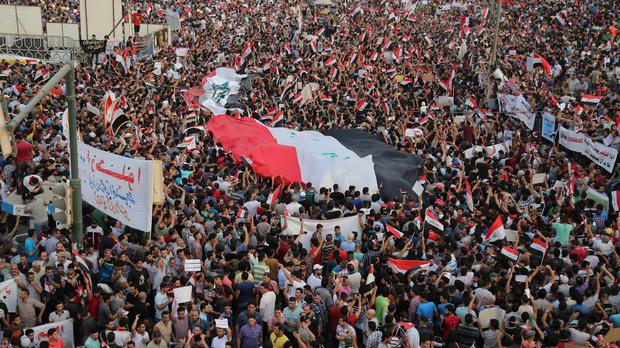Protesters gather in Tahrir Square in Baghdad over government corruption (AP)