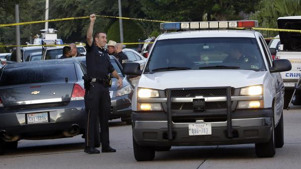 Police at the scene of a shooting at a home in Houston which left eight people dead (AP)