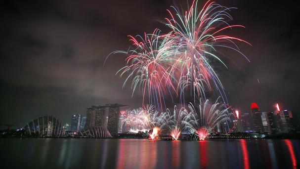 Fireworks explode above Singapore's financial skyline as part of celebrations for the nation's 50th year of independence (AP)