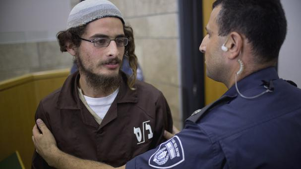 Head of a Jewish extremist group Meir Ettinger appears in court (AP)
