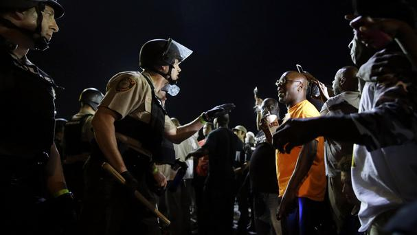 Officers and protesters face off along West Florissant Avenue in Ferguson (AP)