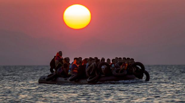 A dinghy arrives at the south-eastern island of Kos, Greece (AP)