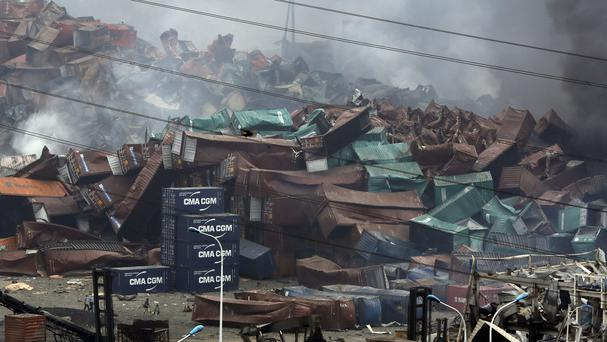Deformed containers pile up at the site of the Tianjin explosions (AP)