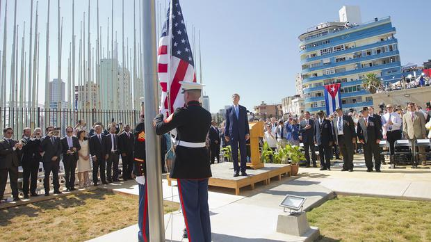 John Kerry and other dignitaries watch as US marines raise the US flag over the newly reopened embassy in Havana, Cuba. (AP)