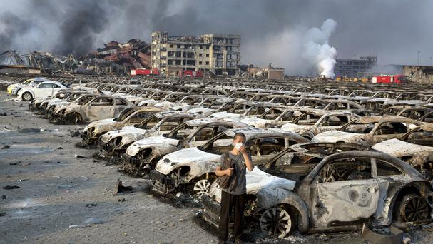 The charred remains of new cars at a site near the warehouse explosion (AP)