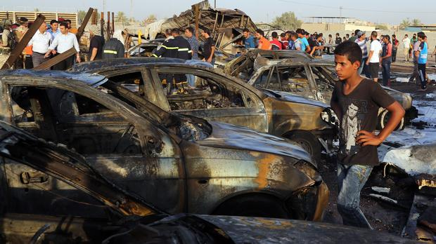 The scene of the deadly car bomb in the Habibiya neighbourhood of Sadr City, Baghdad (AP)
