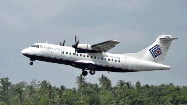 The same type of Trigana airliner seen in this photo has lost contact with ground control in Indonesia while carrying 54 people (AP)