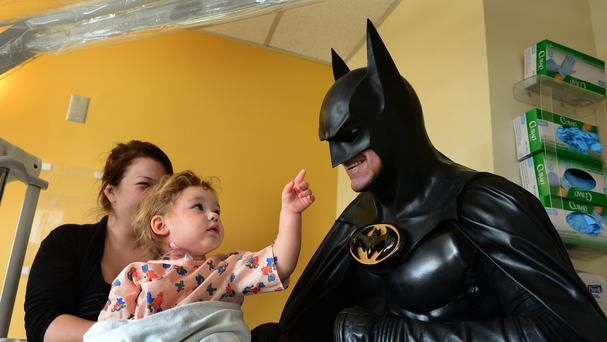 Leonard Robinson delighted thousands of children by impersonating Batman at hospitals and charity events (AP)