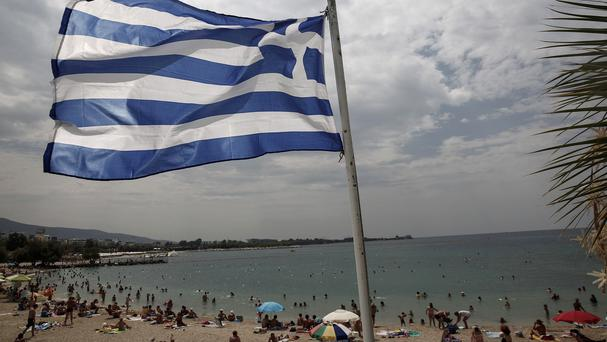 Greeks will be able to send small amounts of money abroad for the first time in about two months