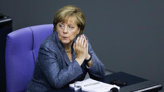 German Chancellor Angela Merkel attends a debate at the German parliament prior to a vote on another bailout package for Greece. (AP)