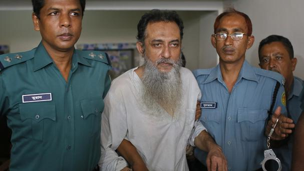 Suspected member of the banned Islamic militant outfit Ansarullah Bangla Team, Touhidur Rahman, is escorted by police to a court in Dhaka. (AP)