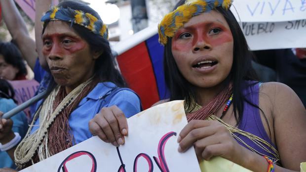 Indian women from the Amazon region of Ecuador take part in a protest march in Quito (AP)