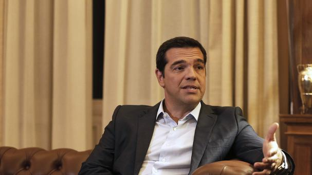 Alexis Tsipras announced his government's resignation and called early elections (AP)