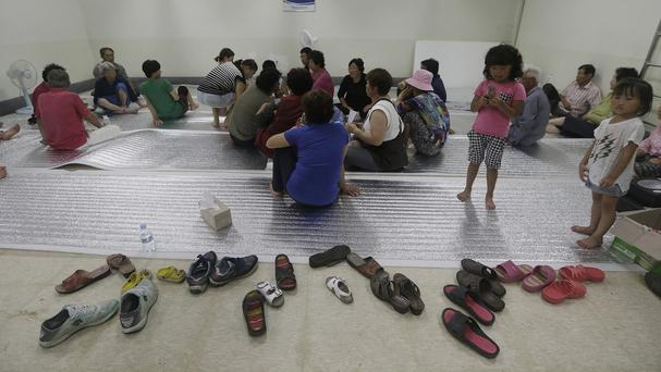 Residents gather at a shelter in the South Korean town of Yeoncheon (AP)