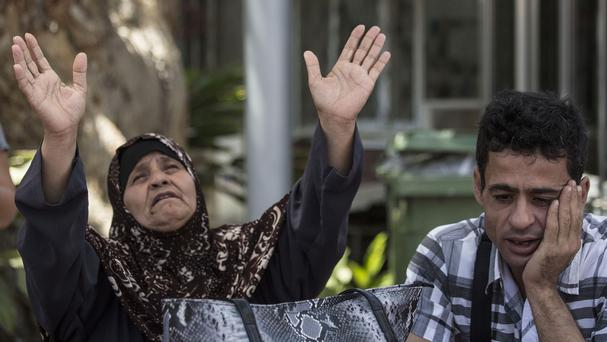 Relatives of Mohammed Allan wait outside Barzilai Hospital in Ashkelon, southern Israel. (AP)
