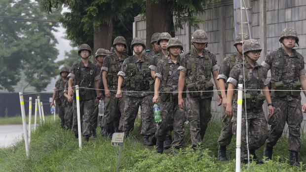 South Korean army soldiers return to their base after a patrol, in Paju, south of the demilitarised zone (AP)