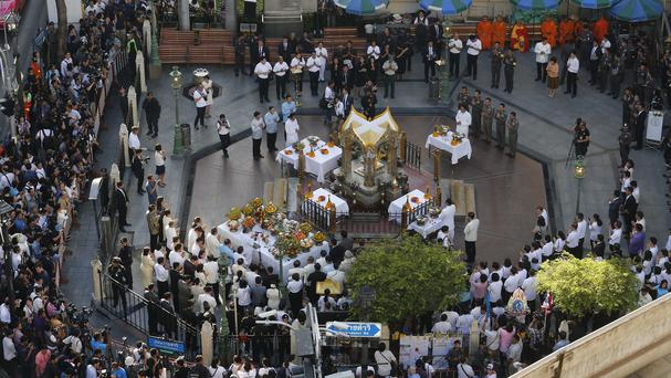 Thai officials and diplomats gather at the Erawan Shrine four days after 20 people died in a bomb attack (AP)