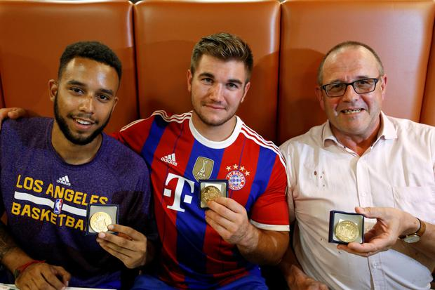 HEROES: Anthony Sadler, from Pittsburg, California, Alek Skarlatos from Roseburg, Oregon, and Chris Norman, a British man living in France (L-R) — three men who helped to disarm an attacker on a train from Amsterdam to France — pose with medals they received for their bravery at a restaurant in Arras, France