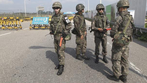 South Korean soldiers stand guard on Unification Bridge, which leads to the demilitarised zone (AP)