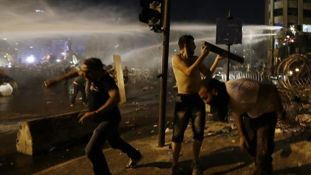 Lebanese activists clash with riot police during a protest against the ongoing rubbish crisis in Beirut (AP)