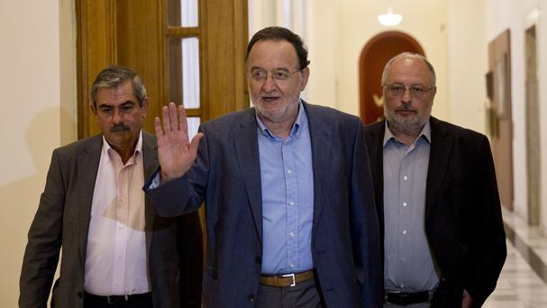 Panagiotis Lafazanis (centre) arrives for a meeting in the Greek parliament (AP)