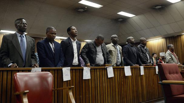 The former policemen were found guilty of the murder and assault of taxi driver Mido Macia. (AP)