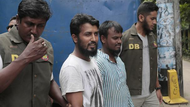 Kausar Hossain Khan, 29, second from right, and Kamal Hossain Sardar, 29, second from left, were arrested. (AP)
