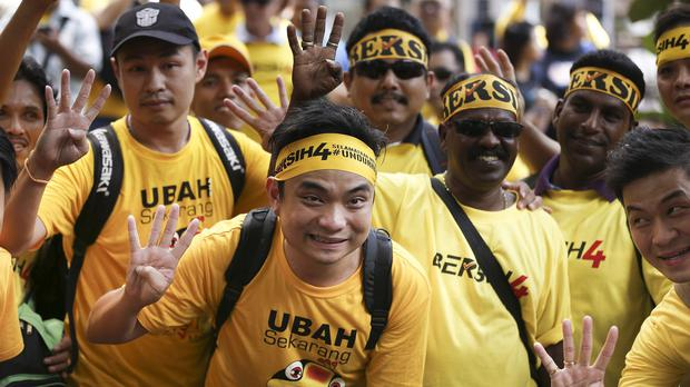 Supporters of pro-democracy group Bersih gather before the start of a rally in Kuala Lumpur (AP)