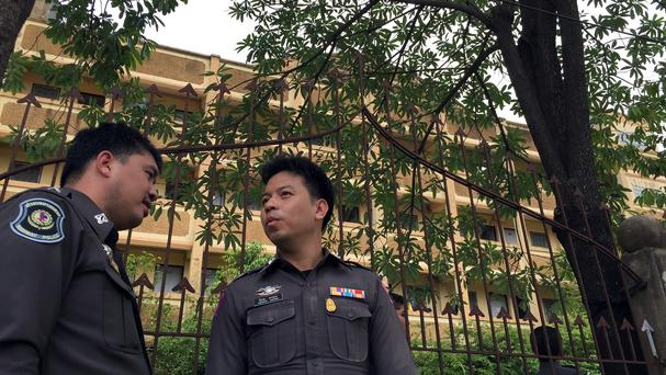 Thai police stand outside an apartment building in Nong Jok on the outskirts of Bangkok in which a bombing suspect was arrested (AP)