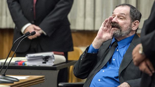 Frazier Glenn Miller yells at the jury as they leave after he was found guilty of one count of capital murder, three counts of attempted murder and assault and weapons charges (The Kansas City Star/AP)