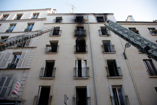 Rescue workers ladders are seen at the damaged building. Photo: AP