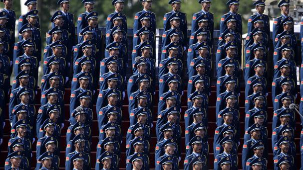 Chinese military personnel sing ahead of the parade commemorating Japan's surrender during the Second World War (AP)