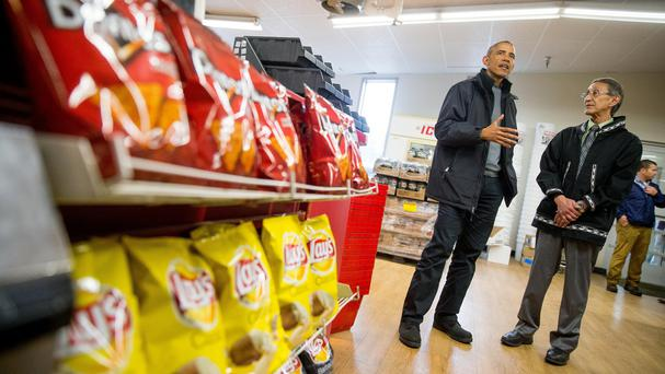 President Barack Obama and Bristol Bay Native Association President Ralph Andrersen at a shop to highlight the high cost of groceries in Alaska, (AP)