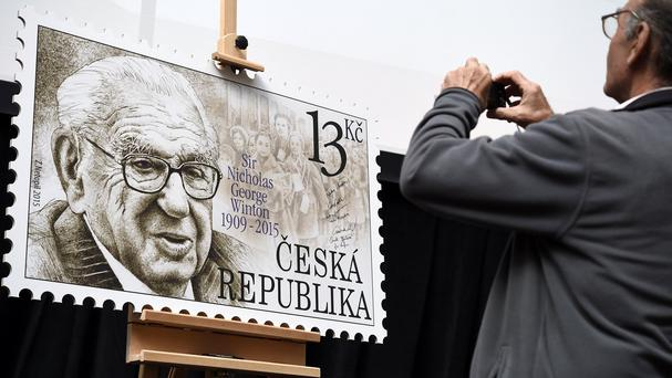 A man takes pictures of a giant postage stamp dedicated to Sir Nicholas Winton, who saved hundreds of Czech Jewish children from the Holocaust (AP/CTK/Roman Vondrous)
