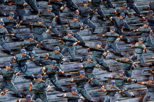 Actors dressed as Red Army soldiers perform at a gala show to mark the 70th anniversary of the end of World War Two, in Beijing, China.