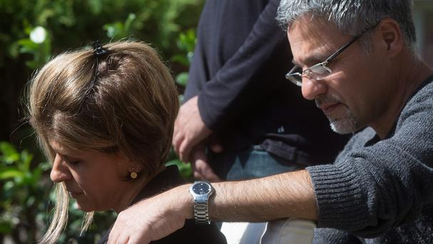 Tima Kurdi is comforted by her husband Rocco Logozzo outside her home in Coquitlam (The Canadian Press/AP)