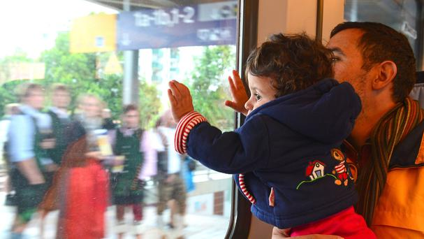 A child and her father travel from Salzburg in Austria to Munich in Germany. (AP)