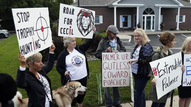 Protesters gather outside the dental practice of Walter Palmer. (AP)