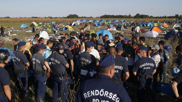 Migrants protest at a makeshift camp for asylum seekers near Roszke, southern Hungary. (AP)
