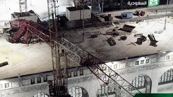 In this still image taken from video released by Saudi TV, a crane is seen collapsed over the Grand Mosque in Mecca, killing dozens (Saudi TV via AP)