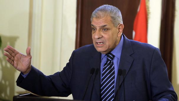 Egyptian Prime Minister Ibrahim Mehleb has handed in his resignation (AP)