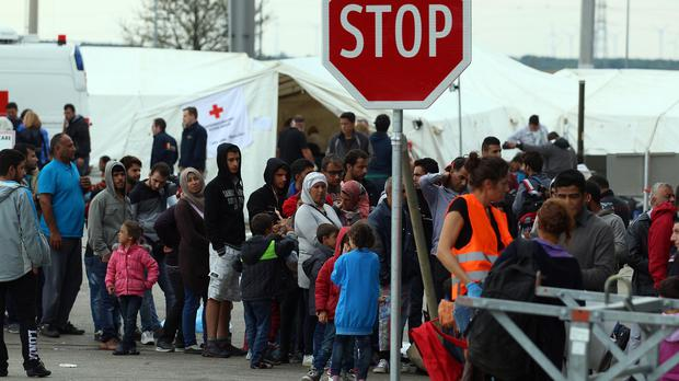 Refugees waiting in Nickelsdorf on the Austria-Hungary border (AP)