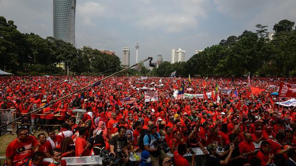 Pro-government 'red shirt' protesters listen to a speech during a pro-government demonstration in Kuala Lumpur, Malaysia. (AP)
