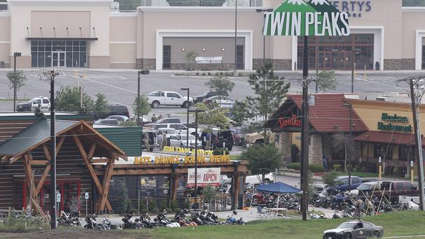 Police investigate the motorcycle gang-related shooting at the Twin Peaks restaurant in Waco. (AP)