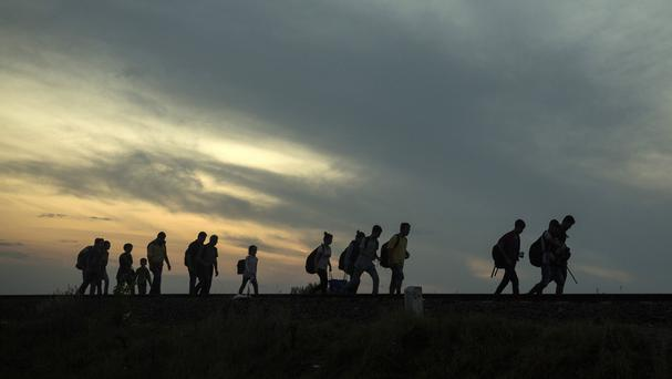 More migrants flooding into Europe are heading for Germany (AP)