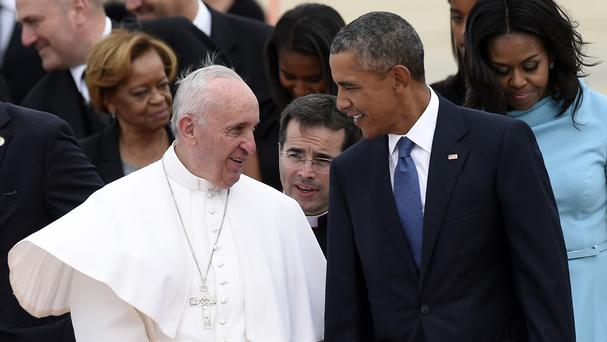 Pope Francis talks with US president Barack Obama after arriving in Washington (AP)