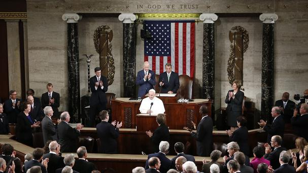 Members of the House and Senate applaud as Pope Francis begins his address before a joint meeting of Congress on Capitol Hill in Washington (AP)